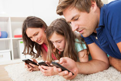 Family using smart phones radiation