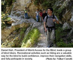world-access-Daniel-Kish-leads-group  hike  with  photo credit